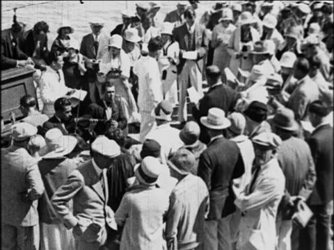 vídeos de stock e filmes b-roll de b/w 1929 high angle crowd of passengers watching band on deck of s.s. honolulu cruise ship / newsreel - artista