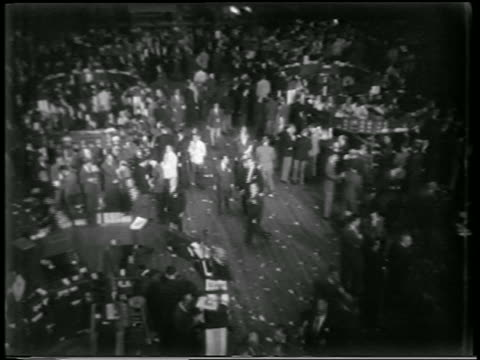 b/w 1951 high angle pan crowd of people in ny stock exchange walking in civil defense drill / nyc / newsreel - wall street lower manhattan stock videos & royalty-free footage