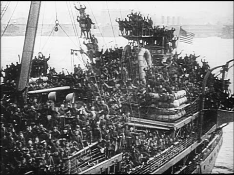 B/W 1918 high angle crowd of soldiers cheering on deck of military ship after end of WW I