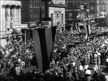 stockvideo's en b-roll-footage met high angle crowd on city street during parade for al smith / documentary - 1928
