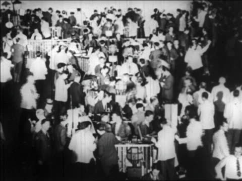 b/w 1929 high angle crowd on floor of new york stock exchange / newsreel - 1929 stock videos & royalty-free footage