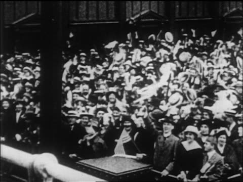 high angle crowd on shore waving to lusitania as it pulls from port / london / newsreel - harbour stock videos & royalty-free footage