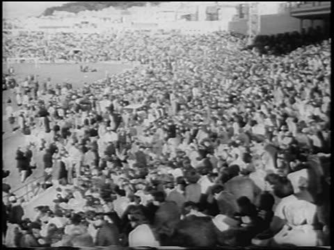 b/w 1967 high angle crowd seated in antiwar demonstration in kezar stadium / san francisco / newsreel - 1967 stock videos & royalty-free footage