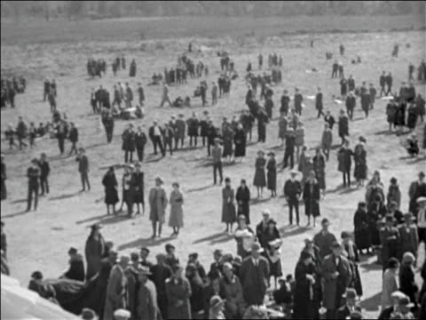 b/w 1928 high angle pan crowd standing in field looking up / documentary - 1928 stock videos & royalty-free footage