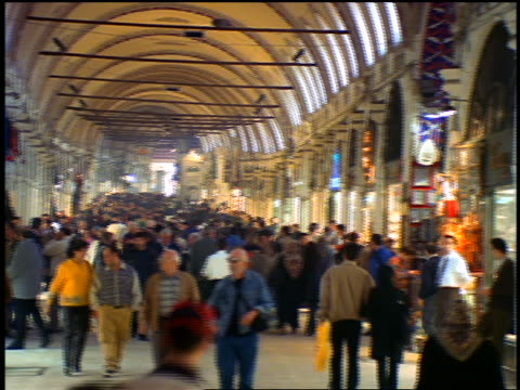 high angle pan crowd walking in covered market / grand bazaar, istanbul, turkey - grand bazaar istanbul stock videos and b-roll footage