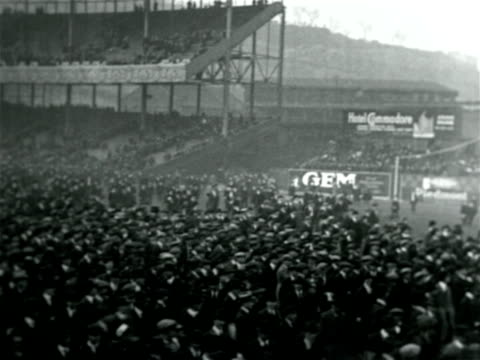 stockvideo's en b-roll-footage met b/w 1921 high angle crowd walking on field after yankees win pennant / documentary - 1921