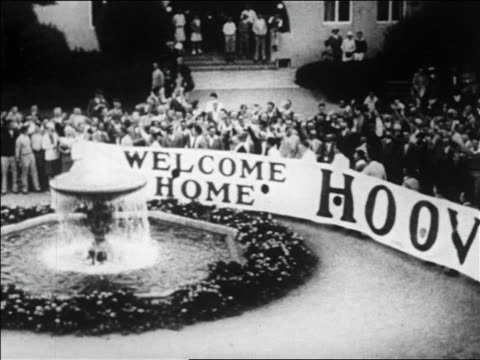"high angle crowd with ""welcome home hoover"" sign by fountain / palo alto, ca / newsreel - 1928 stock videos & royalty-free footage"