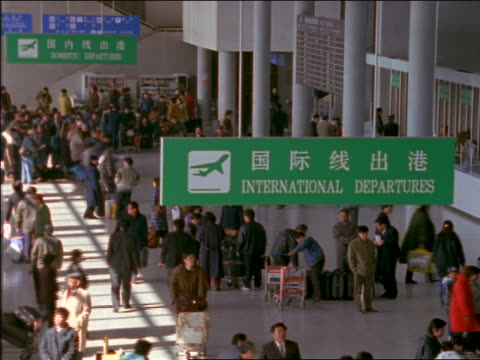 high angle crowded asian airport terminal - cinematography stock videos & royalty-free footage