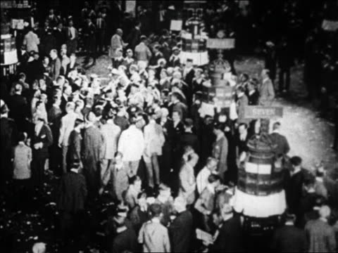 B/W 1929 high angle crowded floor of New York Stock Exchange / Wall Street NYC / newsreel
