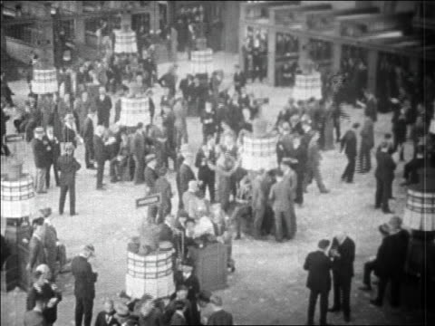 high angle crowded floor of new york stock exchange / wall street, nyc / newsreel - 1920 1929 stock-videos und b-roll-filmmaterial