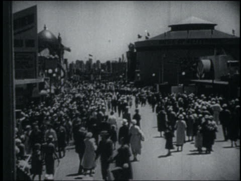 b/w 1933 high angle crowded midway lined with buildings at chicago world's fair - chicago world's fair stock videos and b-roll footage