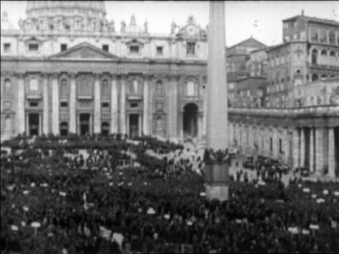 b/w 1929 high angle crowded piazza san pietro / rome / newsreel - catholicism stock videos and b-roll footage