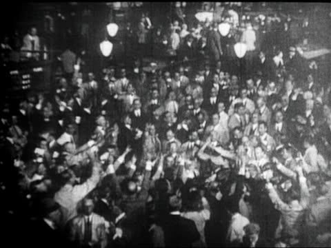 b/w 1929 high angle crowds trading on floor of new york stock exchange after stock market crash / newsreel - 1929 stock videos & royalty-free footage