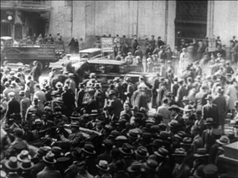 b/w 1929 high angle crowds traffic on wall street / new york city / newsreel - 1929 stock videos & royalty-free footage