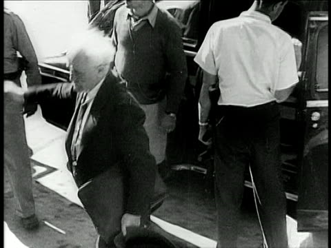stockvideo's en b-roll-footage met b/w 1948 high angle pan david bengurion exiting car saluting / israel / documentary - 1948