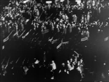 stockvideo's en b-roll-footage met high angle delegates on floor of democratic national convention / houston / documentary - 1928