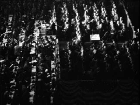 b/w 1928 high angle delegates seated at republican national convention / kansas city / newsreel - 1928年点の映像素材/bロール