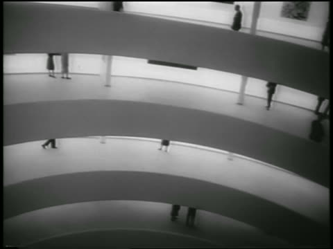 high angle different levels of guggenheim museum with people / nyc / newsreel - 1959 stock-videos und b-roll-filmmaterial