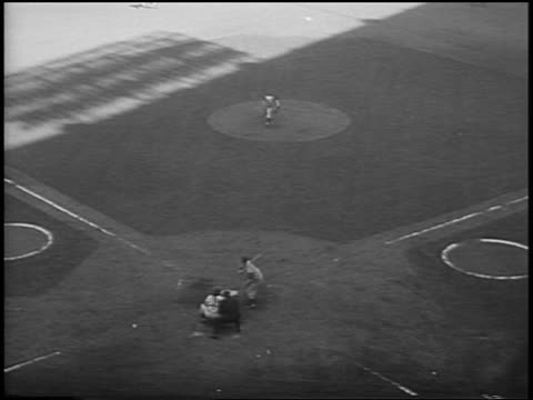 b/w 1956 high angle don larsen pitching a 'perfect game' with dale mitchell trying to hit missing ball during game 5 of the world series - baseballmannschaft stock-videos und b-roll-filmmaterial