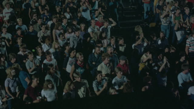 high angle down shot of rock concertaudience - rocking stock videos & royalty-free footage