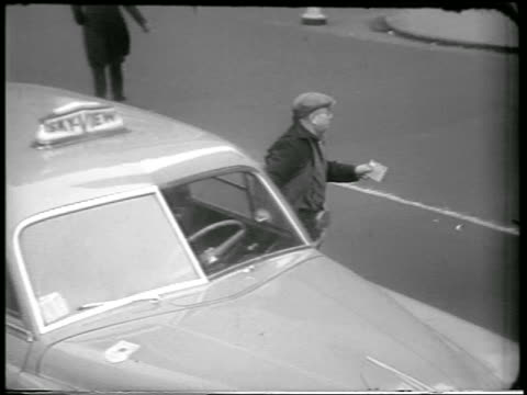 high angle driver gets out of taxi + runs toward building in civil defense drill / nyc / news. - 1951 stock videos & royalty-free footage