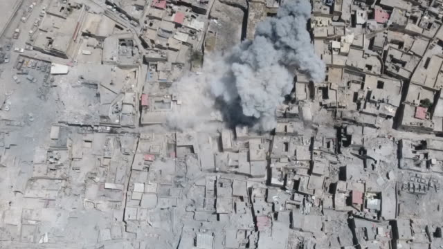 high angle drone footage showing airstrikes in mosul, iraq with explosions, smoke plumes and fire balls. - fireball stock videos & royalty-free footage