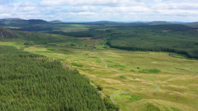 high angle drone view of an area of forest in rural south west scotland - galloway scotland stock videos & royalty-free footage