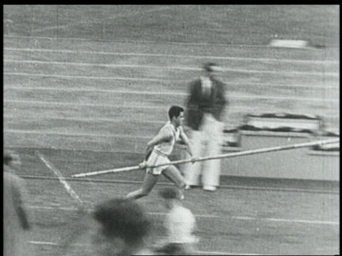 B/W 1936 high angle PAN Earle Meadows running in pole vault competition / Summer Olympics Berlin