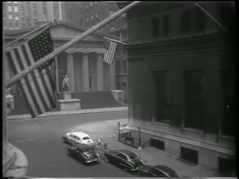 b/w 1951 high angle empty street in front of federal hall in wall street area during civil defense drill - 1951 stock videos & royalty-free footage