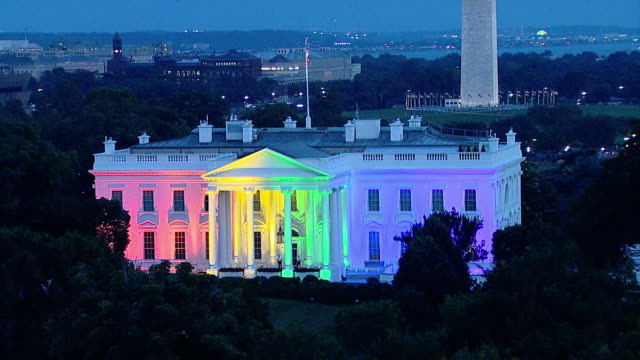 high angle establishing shot of the white house exterior lit up in rainbow colors after the supreme courtõs decision to legalize same-sex marriage... - 2015 stock videos & royalty-free footage