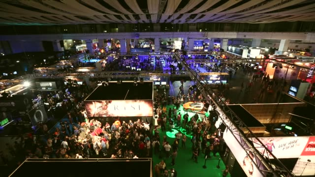 high angle extreme long shot, video game enthusiasts play the latest release games at the eurogamer expo at earls court exhibition centre on... - earls court stock videos & royalty-free footage