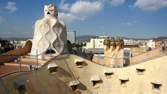 High angle fast motion wide shot people walking on roof of La Pedrera/ Barcelona