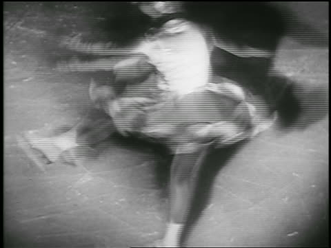 b/w 1935 high angle female figure skater spinning on ice rink / richmond canada - 1935 stock videos & royalty-free footage