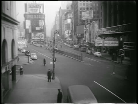 b/w 1951 high angle few policemen stand on empty times square street during civil defense drill / newsreel - 1951 stock videos & royalty-free footage