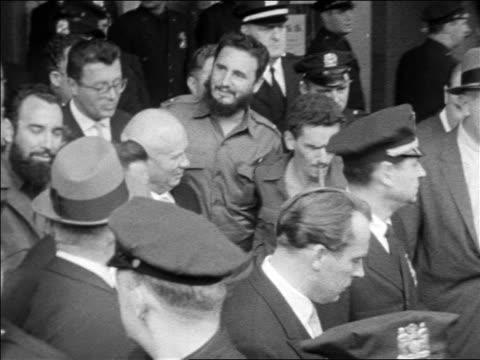 b/w 1960 high angle pan fidel castro nikita khrushchev walking thru crowd smiling waving / usa - fidel castro stock videos and b-roll footage