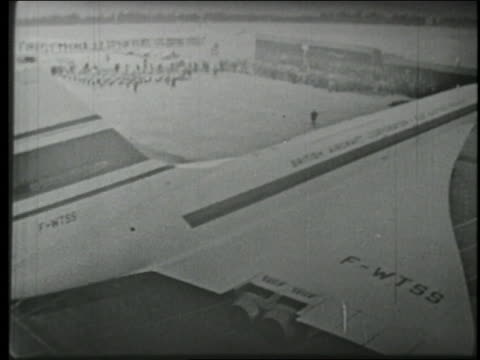 B/W 1969 high angle first Concorde plane being towed out of airplane hangar in France