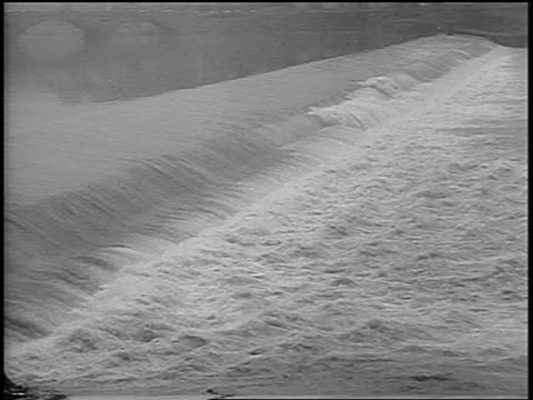 b/w 1966 high angle flooded arno river / florence italy / newsreel - 1966 stock videos & royalty-free footage