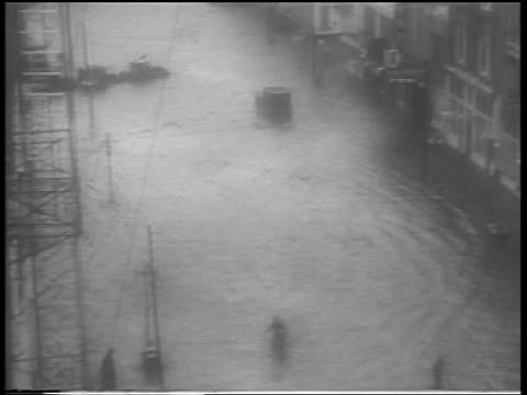 vídeos de stock, filmes e b-roll de high angle flooded street in rain during hurricane / northeast us / newsreel - high street