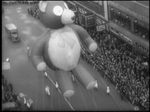 B/W 1945 high angle giant teddy bear balloon in Macy's Thanksgiving Day parade / NYC / newsreel