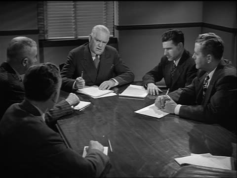 stockvideo's en b-roll-footage met b/w 1948 high angle group of businessmen sitting at conference table having meeting / yourtown, usa - 40 49 jaar