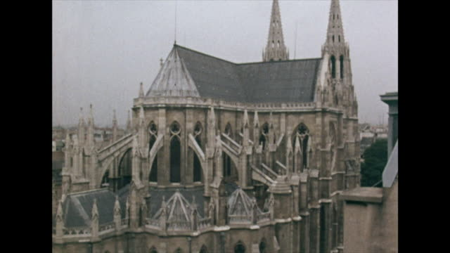 high angle gvs of paris and notre dame cathedral; 1972 - national assembly stock videos & royalty-free footage