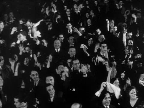 b/w 1932 high angle happy crowd cheering waving / election night - 1932 stock videos & royalty-free footage