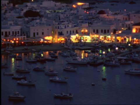 high angle harbor + coastal town at night / mykonos, greece - mykonos stock videos and b-roll footage