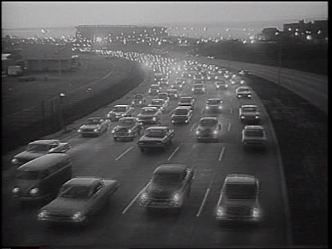 high angle heavy traffic on highway in early evening / nyc / newsreel - 1966 stock videos & royalty-free footage