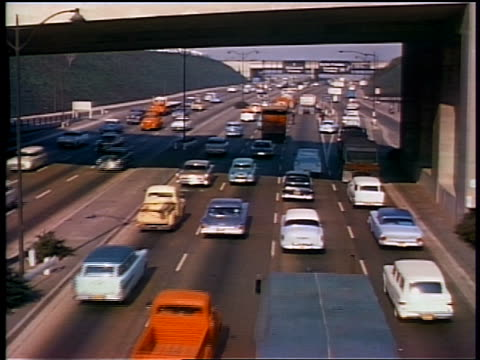 1959 high angle heavy traffic on highway / los angeles - 1950 1959 stock-videos und b-roll-filmmaterial