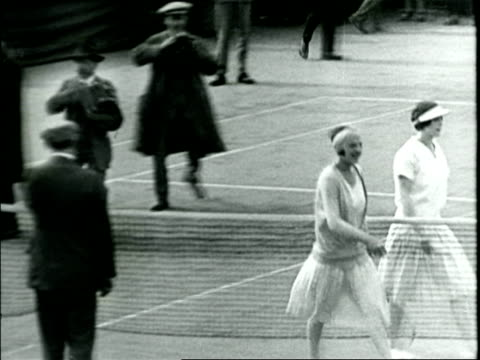 b/w 1926 high angle helen wills shaking hands with suzanne lenglen after losing match / france / documentary - 1926 stock videos & royalty-free footage