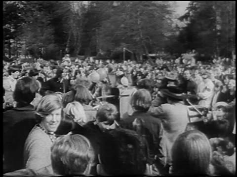 vídeos de stock e filmes b-roll de b/w 1967 high angle hippie crowd band at bein / seattle / newsreel - love in