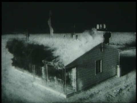 B/W 1952 high angle house being blown away by hydrogen bomb explosion / Eniwetok / newsreel