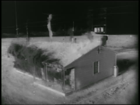 SOLARIZED high angle house exploding during atomic bomb explosion test / Nevada