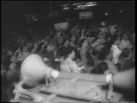 b/w 1962 high angle pan huge crowd at demonstration at night / cuban missile crisis / newsreel - cuban missile crisis stock videos & royalty-free footage